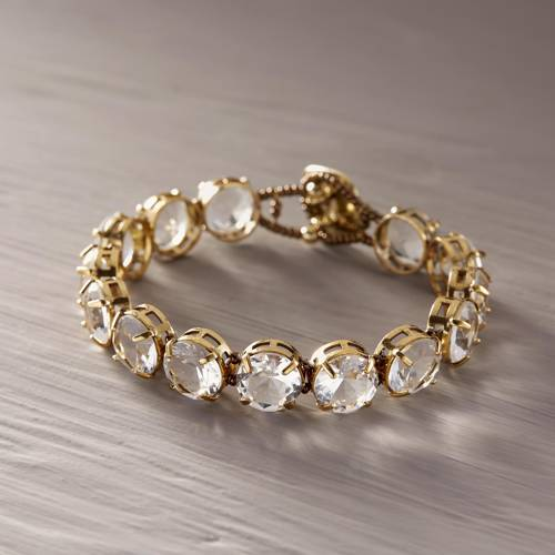 Clear as a whistle. Gold plated bracelet with crystals
