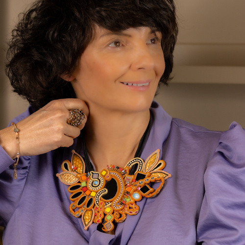 Close to nature. Golden bracelet with natural stones and beads