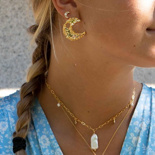 Enchanting. Little golden moon-shaped earrings