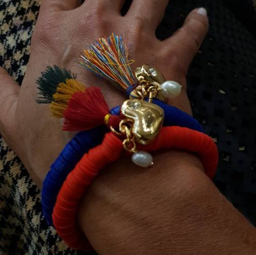 Fiery heart. Red bracelet with a tassel