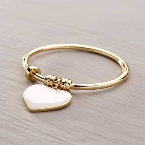 First love. Cuff bracelet with a white heart