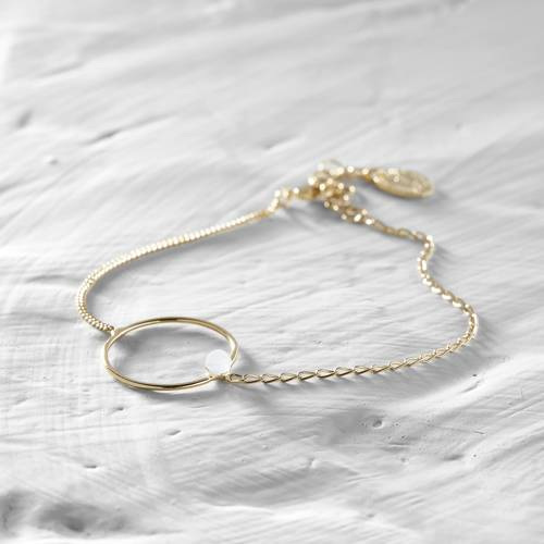For a princess. A delicate chain bracelet with a white crystal