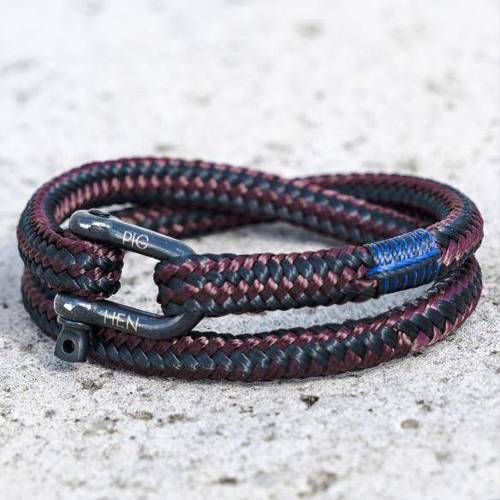 For the adventurer. A dark red bracelet with a shackle
