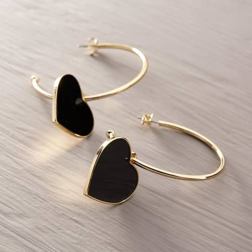 Harley, darling. Golden earrings with black hearts