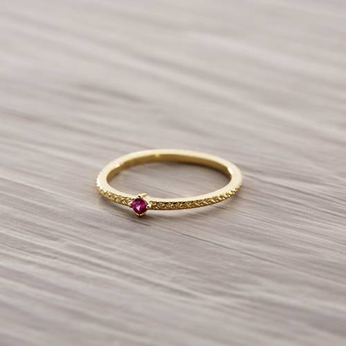 Love it. Delicate ring with a ruby colored zirconia