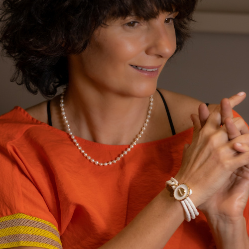 Miss Angel. White bracelet with charms