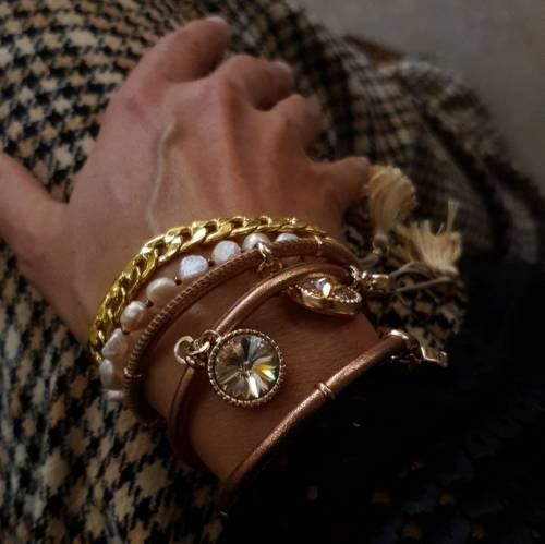 Soft hearts. Leather bracelet with crystal charms
