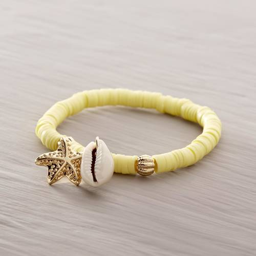 Surf the wave. Yellow bracelet with a conch