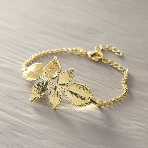 The young bride. Rose twig on a chain bracelet