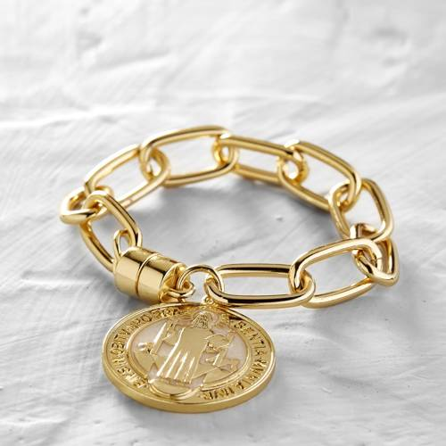 Woman in power. Bracelet with a coin